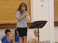 Girl playing assembly music